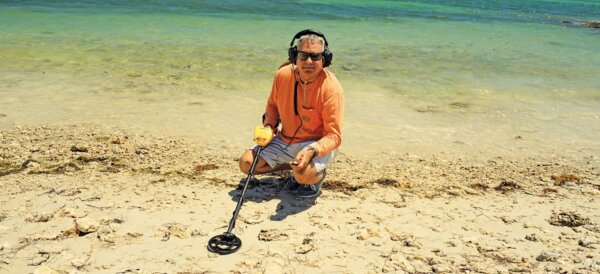 Author walks along North Vero beach scanning for treasure. Photo by Rafael Lima