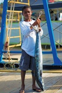 Young angler Tristan Potter with a 25.2lb Kingfish caught on Sixpence. Photo: ASF/Nathan Shadrach