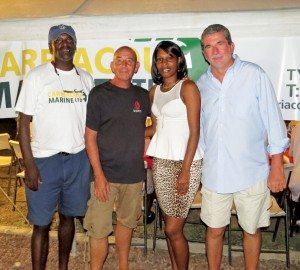 Warm welcome in Tyrell Bay (from left): Trevor Stanislaus, Carriacou Marine Services; Rene Froehlich, PCYC Commodore; Ms Shanel Edmund, Grenada Tourism Authority, Carriacou Office, and Piero Zipoli, Tyrell Bay start/finish boat captain. Photo: Connie Martin