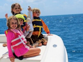 Macy Barringer (6), Ben Barringer (4), Willy Gerritsen (6) and Charlie Gerritsen (5) all from St Thomas get ready to launch their 'message in a bottle' off the coast of Anegada