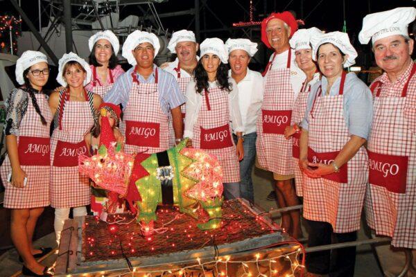 Christmas at Club Nautico de San Juan and time to kiss the cook. Photo courtesy of Virginia de los Reyes, CNSJ