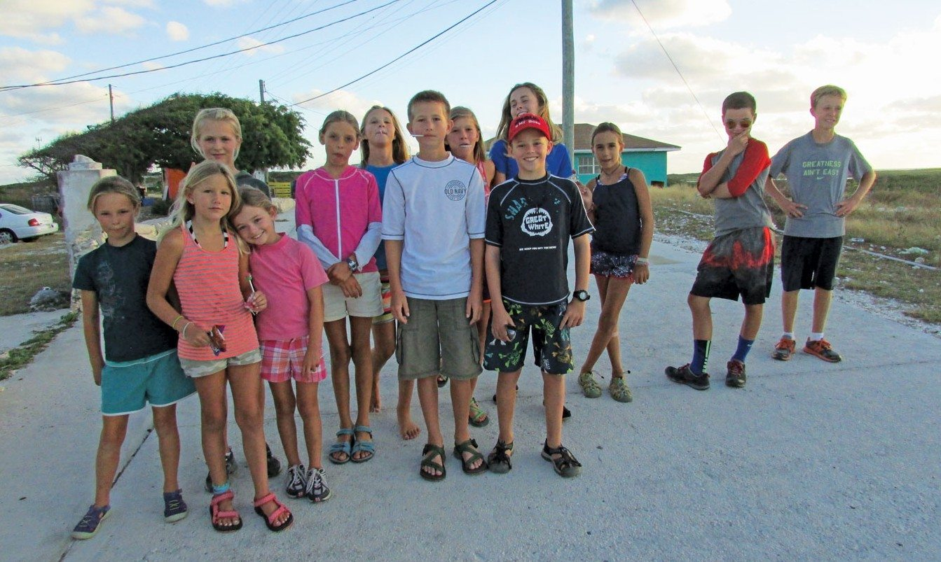 Cruising the Ragged Islands: The boat kids in Duncan Town. Photo by Rick Caroselli