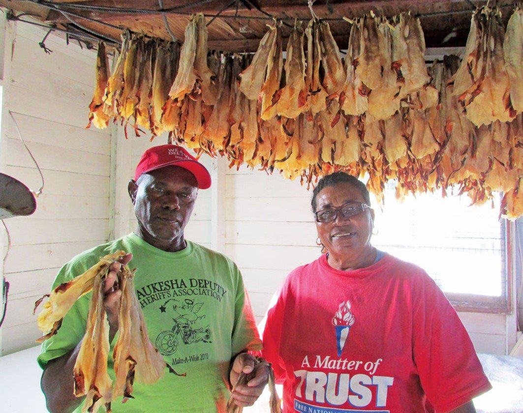 Cruising the Ragged Islands:Maxine and her husband with dried conch. Photo by Rick Caroselli