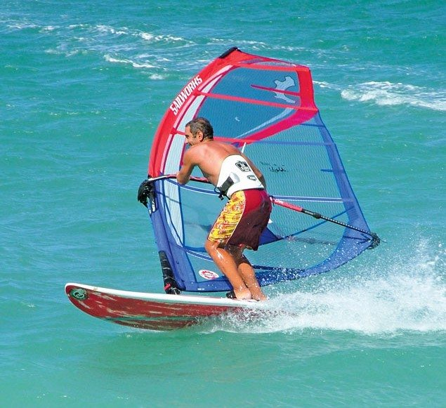 Bonaire Windriders: A windsurfer with modern gear tilts the rig and carves the board to perform a planing jibe (downwind turn). Photo: MerryfranksteratEnglish Wikipedia
