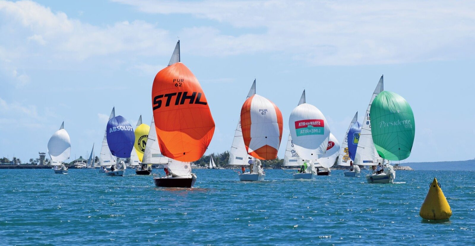Discover the Caribbean: IC 24s, the largest fleet in the regatta, race to the gate. Photo by Maria Fernanda Rodriguez