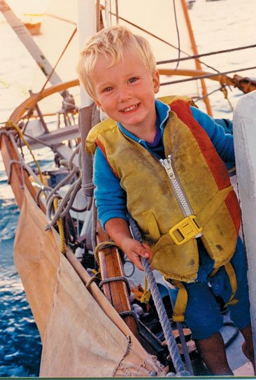 Boat cruising with kids. Our son Kess, age two, sailed 10,000 that year and needed a new life jacket!. Photo by Janet Hein