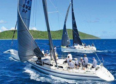 St. Croix International Regatta: Downwind Spinnaker Class start, race to Christiansted: Pipedream, Bad Monkey (ex-Luxury Girl), and Dark Star. Photo: Ellen Sanpere