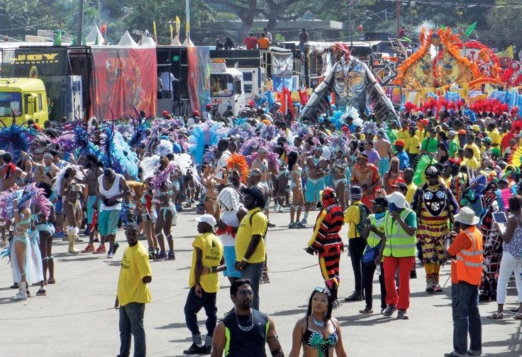 Trinidad shuts down for the annual Carnival and blaring music and Return to Grenada: A Cruiser remembers an Invasion: dazzling costumes take over the streets