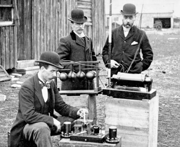 British Post Officeengineers inspectGuglielmo Marconi's wireless telegraphy(radio) equipment, during a demonstration onFlat Holm Island, 13 May 1897. This was the world's first demonstration of the transmission of radio signals over open sea, between Lavernock Point and Flat Holm Island, a distance of three miles.