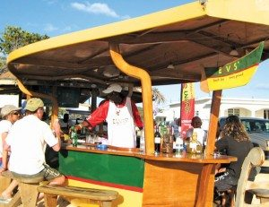 Sandy Spirits: Beach Bars That Rock He definitely has not left the building - Elvis' Beach Bar, Anguilla. Photo by Jan Hein