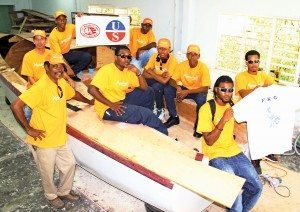 We built a race boat! All hands on deck ... and a thank you to some of the sponsors. Photo: OceanMedia