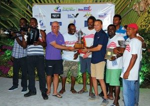 Grenada Sailing Week: The crew of Apero collects the trophy and prizes as Best Performing Yacht of the regatta. Photo: Tim Wright