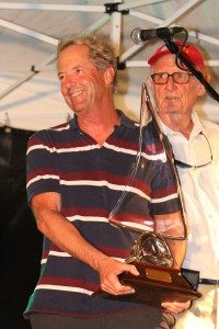 Steve Benjamin, from Norwalk, CT, wins 'Wing and Prayer' perpetual trophy for fastest elapsed time Round the Rocks. Benjamin sails his TP 52, Spookie. Credit: Ingrid Abrey