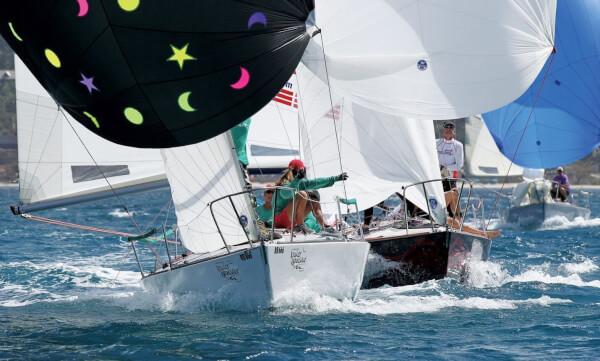 The J24 Glory Daze is ambushed by eventual class winner Island Water World Die Hard. Photo: Tim Wright