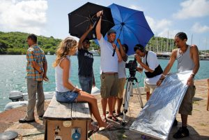 Caribbean movie destinations: Peter Williams (multi-coloured shirt) and Lisa Reynolds during the making of the movie The Skin, on location in historic Nelson's Dockyard, English Harbour. Photo courtesy HaMa films, Antigua