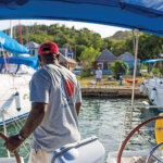 Docking with Dignity: Receiving hands-on tips about Mediterranean mooring from Sunsail Antigua stafferClive Gilgeours. Photo: www.sherryspix.com