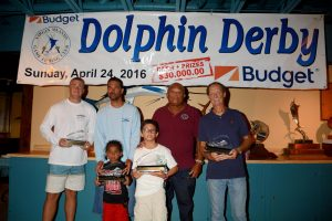 Awards, l to r: John Clark (third place angler), Capt. Alvin Turbe (top boat), Alvin Turbe Jr. (standing in front), Robbie Richards (first place angler), Capt. Red Bailey, president of the Virgin Islands Game Fishing Club, Mike Holt (second place angler). Credit: Dean Barnes