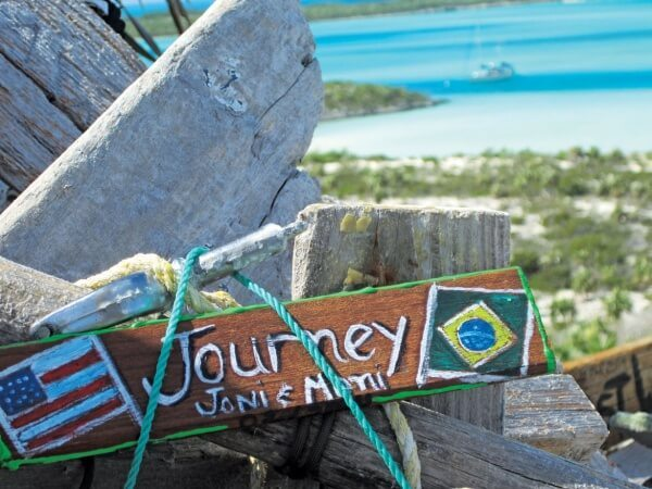 Warderick Wells Bahamas : Journey's memento joins those left by other yachties on the 'cairn' atop Boo Boo Hill. Photo by Monica Pisani