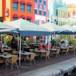 Curacao Papiamento Island : Traditional Amsterdam architecture combined with Caribbean colors makes for a whimsical and attractive setting for diners in downtown Willemstad