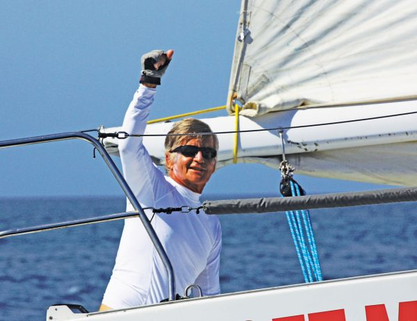 Anguillas Sweet Regatta : Sir Robbie Ferron celebrates as Ossenfeffer crosses the finish line