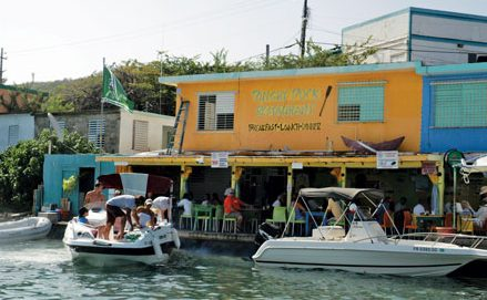 New owners have repainted the Dinghy Dock, but it still a colorful place to dine. Photo by Dean Barnes