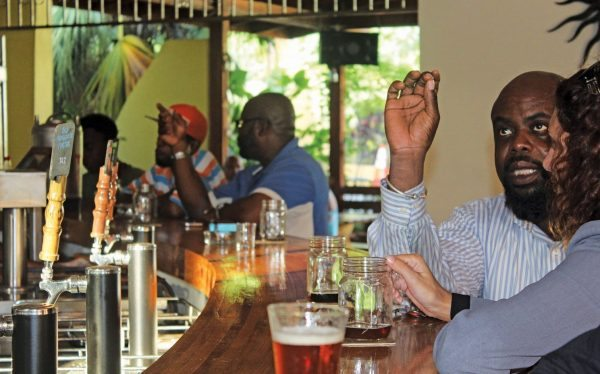 Happy to be here - Patrons at the bar at West Indies Beer Co