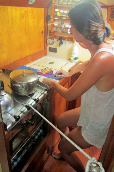 The chef wedged in next to our gimbaled kerosene stove. Photo by Birgit Hackl