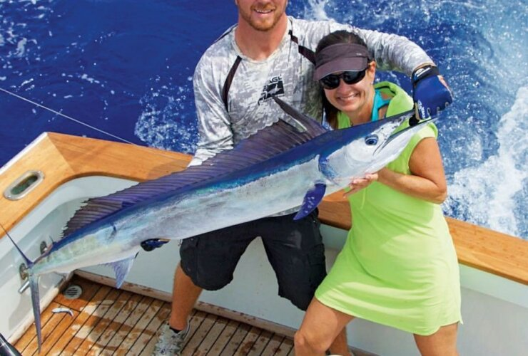 On her way to a Billfish Royal Slam – Julie Crispin seen here with Ryan Thurner, mate of Marlin Magic in Kona, Hawaii