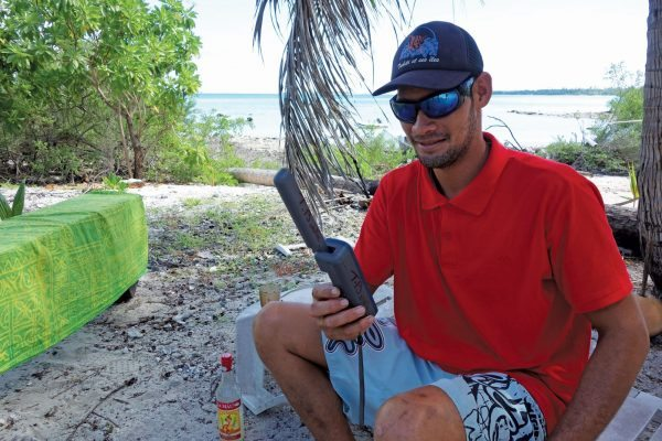 Locals on remote islands often use satphones to stay in touch. Here's Inmarsat in use on Maupihaa. Photos by Birgit Hackl and Christian Feldbauer