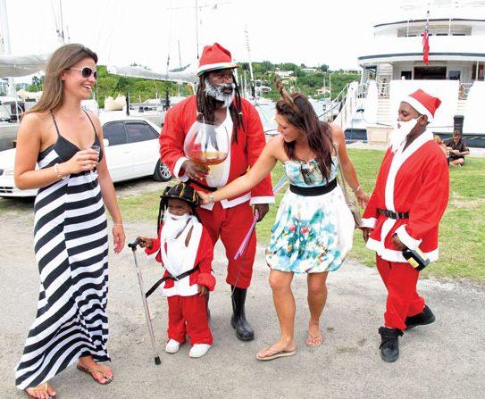 Antigua Santa has two apprentices and plenty of helpers