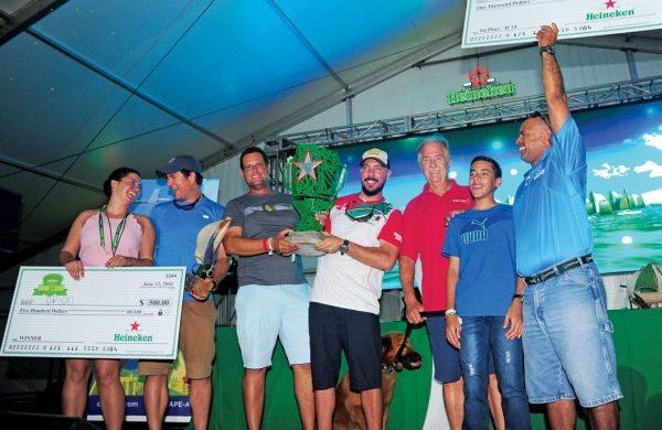 Efrain 'Fraito' Lugo (far right) shares a winning moment with son Alejandro