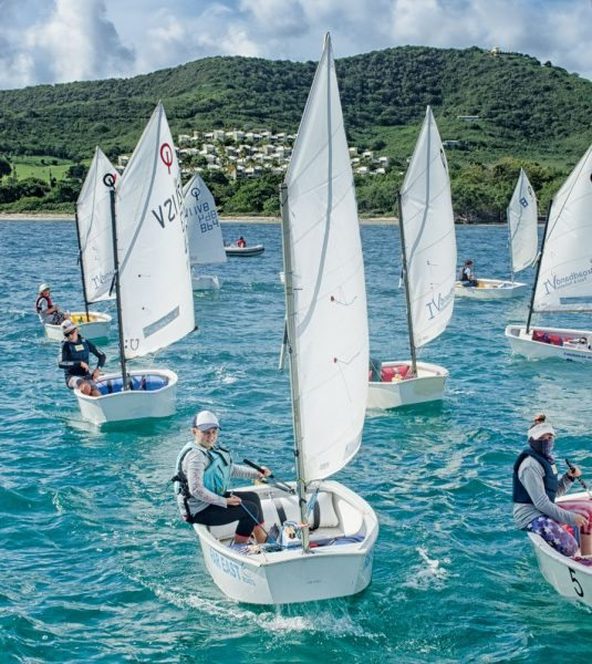 Optis race in the 24th St. Croix International Regatta (Dinghy). Photography by Emelyn Morris Sayre