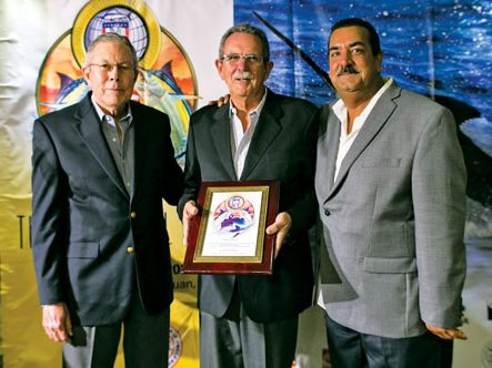Veteran angler Roberto Sabater (center) was honored by the Puerto Rico Light Tackle Anglers for his commitment to the organization during the past 30 years during which he held many positions including president, vice president, and treasurer. Presenting the honors are tournament director Luis Infanzon (right) and Jose Jan Jimenez. Photos by Marcos Caballero