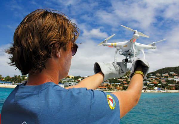 The media team using a DJH Phantom 4 during filming at the St. Maarten Heineken Regatta. Thick leather gloves are a good idea when recovering the drone from a pitching boat. Photo: OceanMedia/Gary Brown