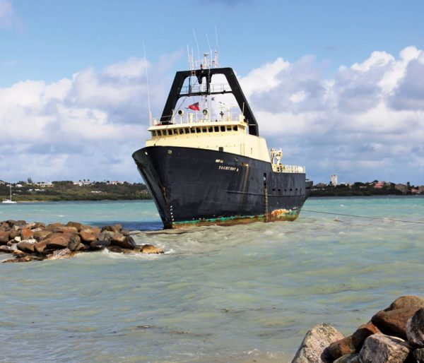 The converted trawler M/V Yacht Hop ashore in Nettle Bay, St. Martin. Photo: Gary Brown/OceanMedia