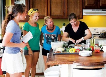 Star chef and instructor Melissa Neidlinger (far right) cooking up a storm at Chef Boot Camp