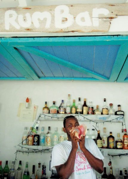 De Rum Bar announces they are open with a blast on a conch shell. Photo Katie Gutteridge
