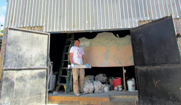 Chris in front of the construction shed. Photo Alexine Hollander