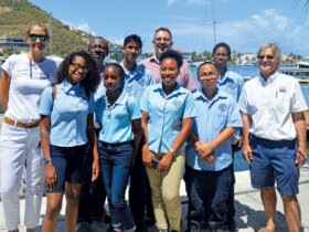 High school students from Milton Peters Collage, St. Maarten, with Ellen van Holland – Little (left) and Eric Knight (3rd left) from Budget Marine; project coordinator Rodger Stringa (check shirt), and Budget founder & director Sir Robbie Ferron (far right)