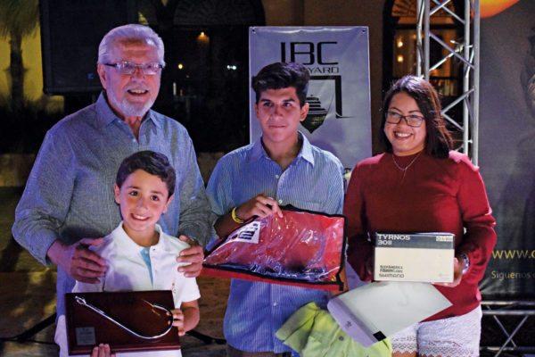 Top Angler Luis Mario Fernandez (left) and his grandson Eduardo Ignacio Fernandez III (holding hook) with Sebastian Maldonado (assistant to tournament director Rick Alvarez); and Kary Gomez, marina marketing executive. Photo: GLEO