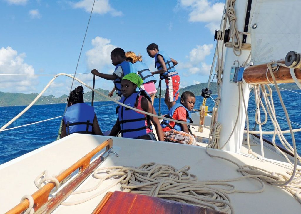 Youngsters get a feel for sailing during a voyage off Jost Van Dyke. Photo: Jost Van Dyke Preservation Society