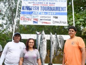 L to R: Julian Aubain, Chelsea Aubain and Lawrence Aubain, Jr. Lawrence caught the tournament's largest kingfish. Credit: Dean Barnes