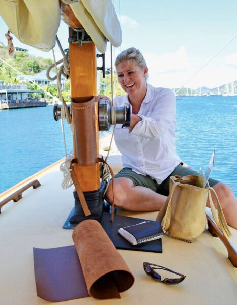Annalea installing a winch handle holder and measuring for a mast boot. Photo by Jan Hein