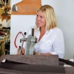 Annalea Mills Leatherwork - Hand tooling a belt. Photo by Jan Hein
