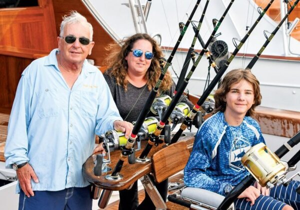 Three generations fish aboard Never Say Never (from left): Jim Carr, Melissa Murck and Zac Murck. Photo: Dean Barnes