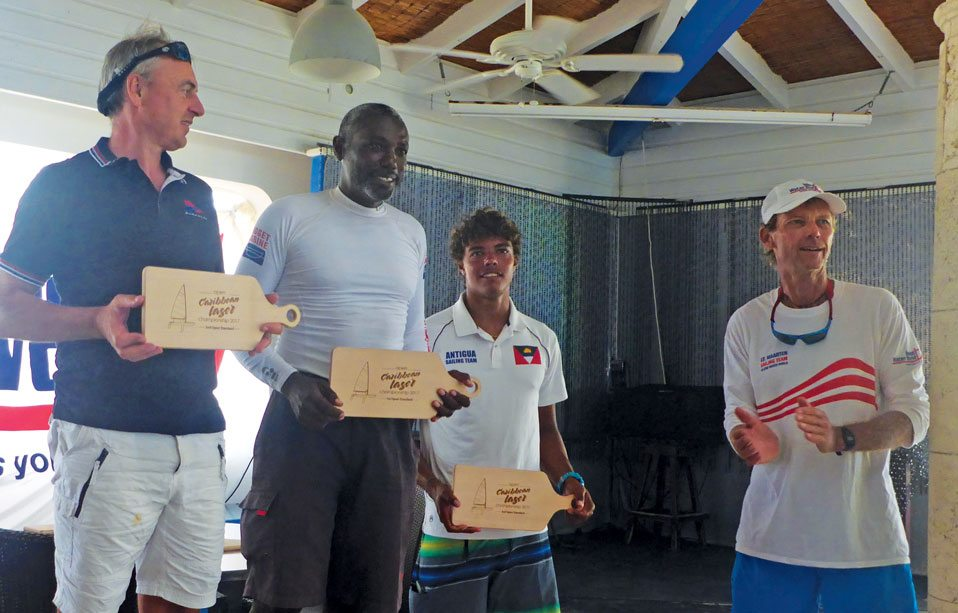 Laser Championships presentation (from left): Benoit Maesemaker (2nd), Karl James (1st), Jules Mitchell (3rd) and regatta organizer Frits Bus