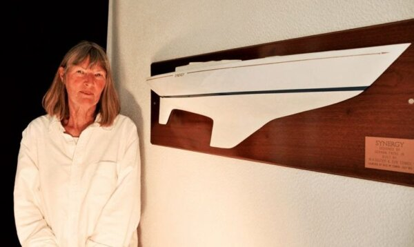 Lea with a half model of her yacht Synergy. The yacht was designed by German Frers and built in England in 1974. In 1999 the yacht was smashed by Hurricane Lenny, leaving Lea swimming for her life