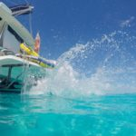 Charter Yacht Something Wonderful making a splash in the warm Caribbean Sea. Photo courtesy of CharterPort BVI