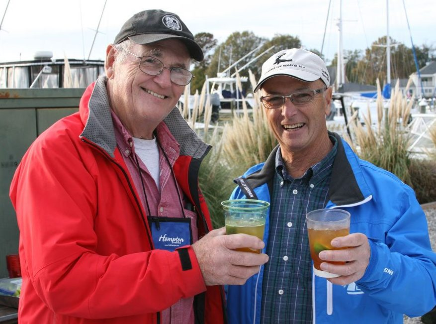Bill Knowles (left), co-founder of the Salty Dawg Rally, shares a dram with one of theSaltyDawgs