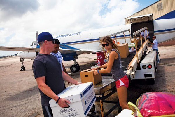 PR residents Nicole Papageorge and Mike Brown and volunteers from Ameriflight load donations from Sailors Helping into a flight bound for Anguilla